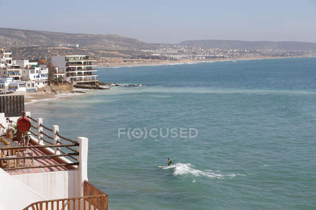 High angle view of person surfing by ocean shore in Taghazout, Morocco — Stock Photo