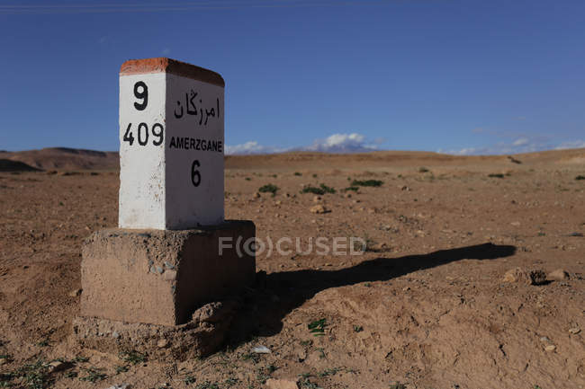 Sign in natural arid landscape of desert of Amerzgane, Morocco — Stock Photo