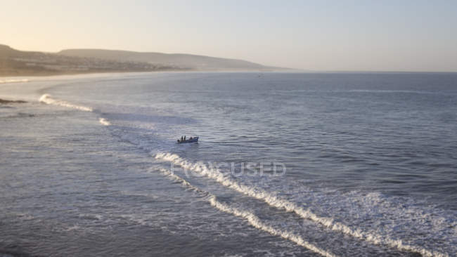 Boat and people on sea shore of African village of  Taghazout, Morocco — Stock Photo