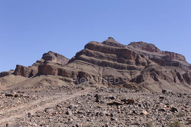 Low angle view of rocky mountains in Jbel Kissane, Agdz, Morocco — Stock Photo