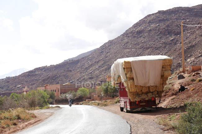 Fully loaded truck on roadside in village of Taddart, Morocco — Stock Photo