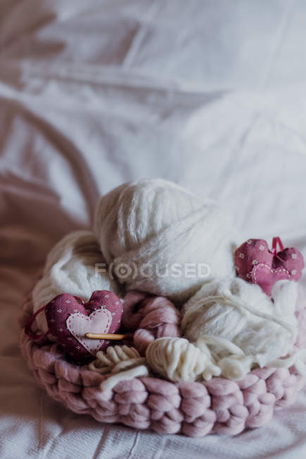 Knitting yarn knitted basket with needles and decorations — Stock Photo