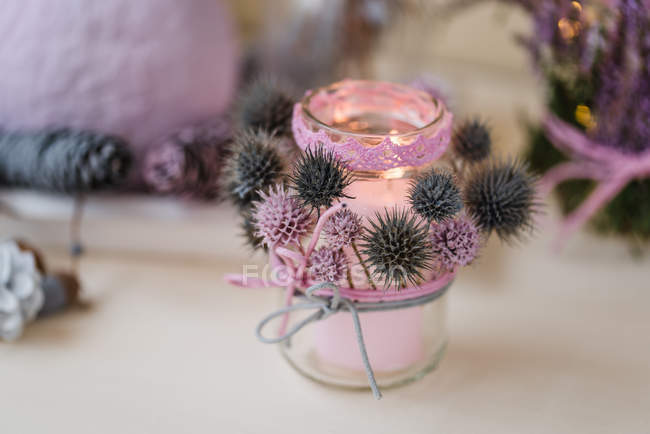 Autumnal lantern decoration with thistles in pastel colors — Stock Photo