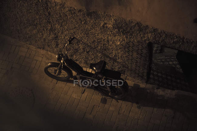 High angle view of motorcycle in dark alley in Marrakesh, Morocco — Stock Photo