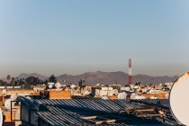 Amazing Marrakesh city view with traditional houses, rooftops and mountains at sunny day, Morocco, Africa — Stock Photo