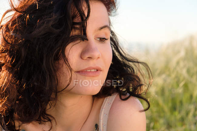 Portrait of young brunette woman, focus on foreground — Stock Photo
