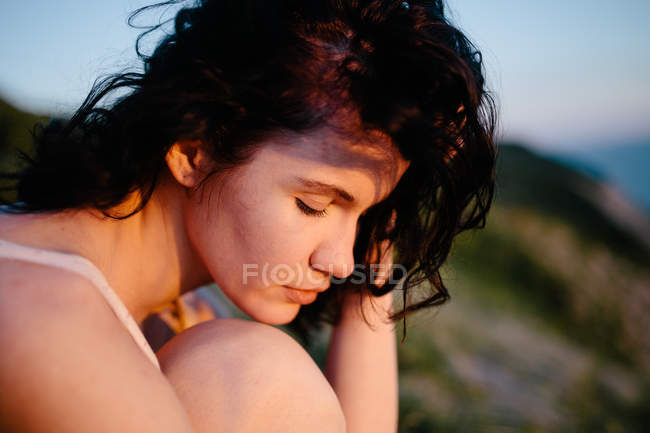 Portrait of beautiful young brunette woman with closed eyes — Stock Photo