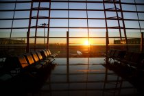 Inside of empty modern airport lounge during sunset — Stock Photo