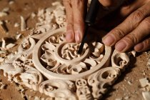 Cropped shot of asian man during woodworking engraving at workshop — стокове фото