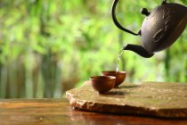 Close-up view of teapot and cups, Chinese tea culture concept — Stock Photo