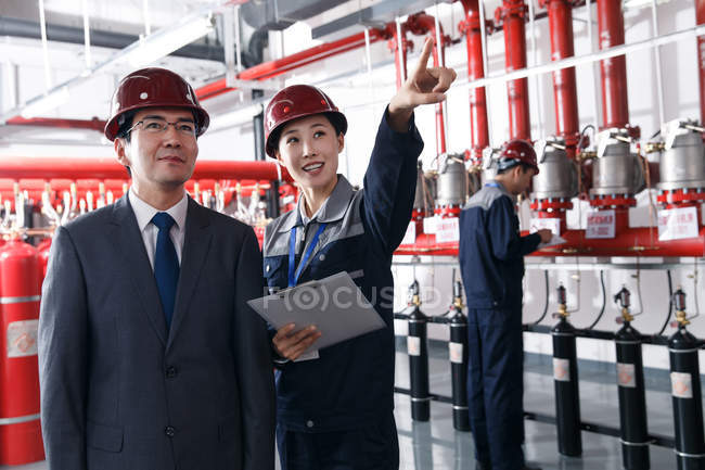 Technical personnel in the factory fire control room inspection — Stock Photo