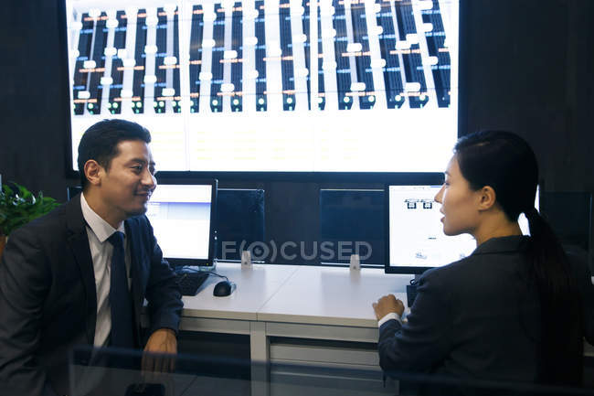 Professional business people working together in the control room — Stock Photo