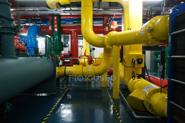 Plant cooling chamber with colorful industrial pipes — Stock Photo