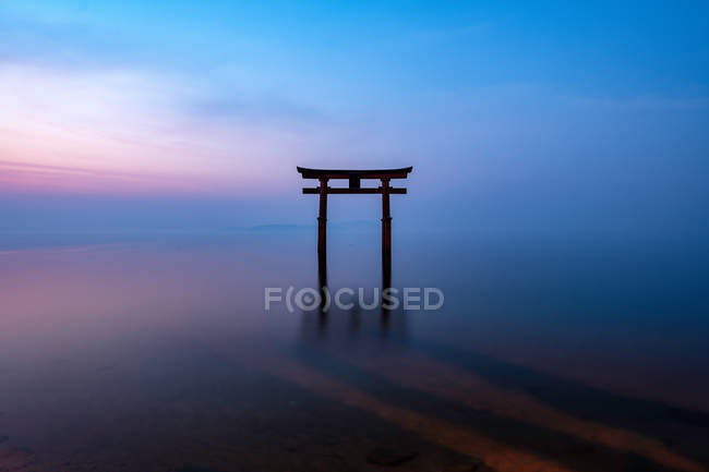 Torii in the biwa lake with a shrine during sunrise — Stock Photo
