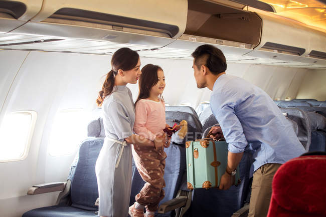 Happy family with one child traveling by plane — Stock Photo