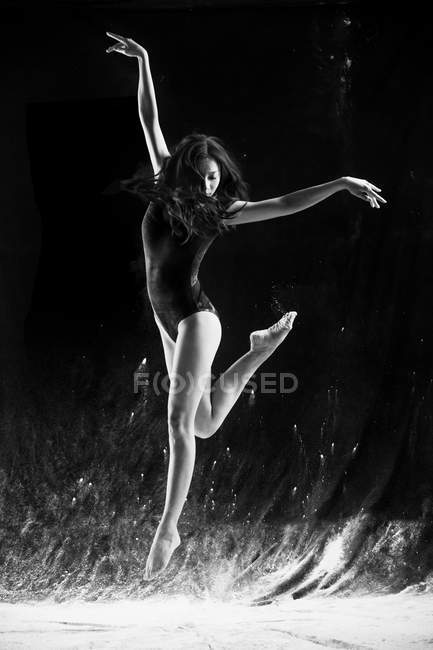 Beautiful young female asian ballet dancer in move — Stock Photo