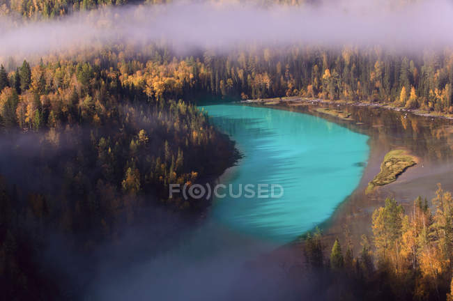 Beautiful landscape with forest and calm blue river in Kanas, Xinjiang, China — Stock Photo