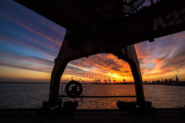 Industrial port at sunset, Qinhuangdao, Hebei, China — Stock Photo