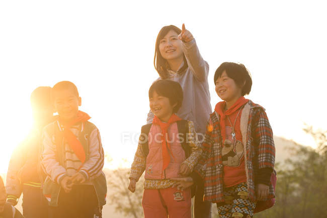Rural female teacher and students during after school activities — Stock Photo