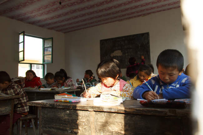Asian school students studying in rural primary school — Stock Photo