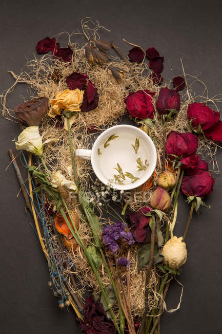 Top view of beautiful various arranged dried flowers and cup — Stock Photo