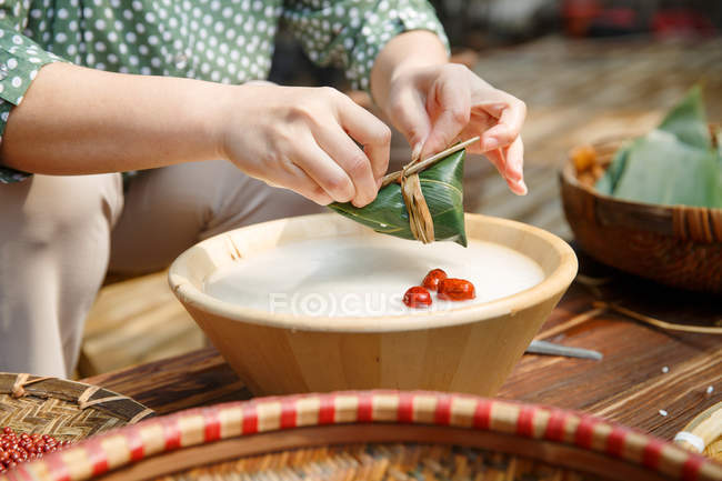 Partial view of woman cooking traditional chinese dish zongzi — Stock Photo