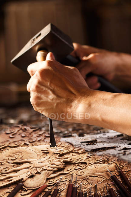 Cropped shot of male hands during woodworking engraving, traditional chinese art and craft — Stock Photo