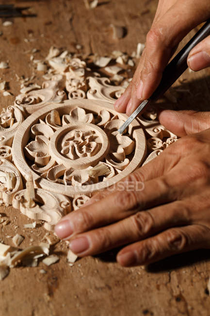 Close-up partial view of male hands during woodworking engraving at workshop — Stock Photo