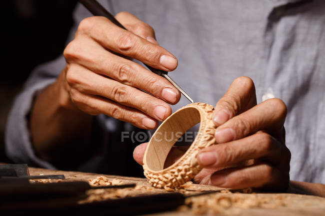 Close-up partial view of man during woodworking engraving at workshop — Stock Photo
