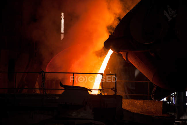 Industrial equipment at illuminated automated steel mill, china — Stock Photo
