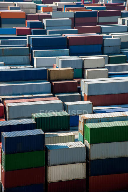 Lot of various cargo containers in harbor at China — Stock Photo