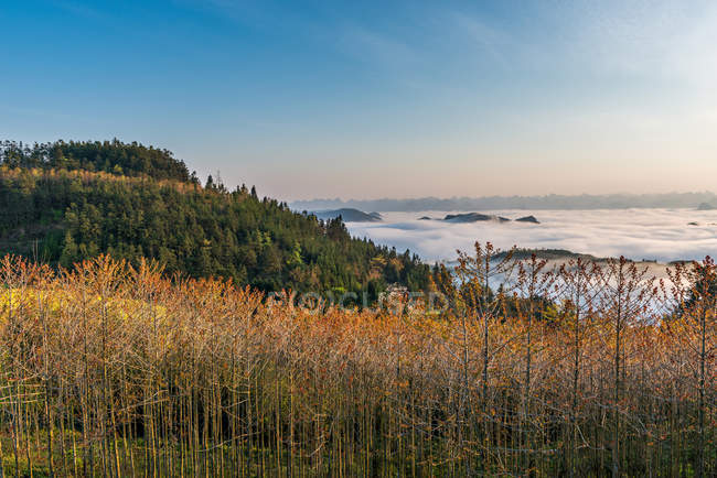 Amazing landscape with scenic mountains covered with clouds at sunrise, Yunnan, China — стокове фото