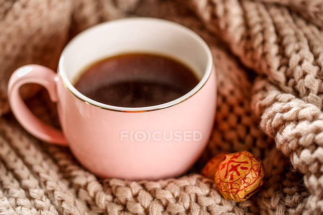 Close-up view of healthy organic herbal tea in cup and candies — Stock Photo