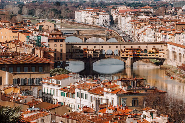 Aerial view of famous ponte vecchio bridge and cityscape in Florence — Stock Photo