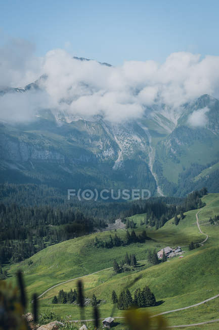 Amazing landscape with beautiful mountains, green vegetation and clouds — Stock Photo