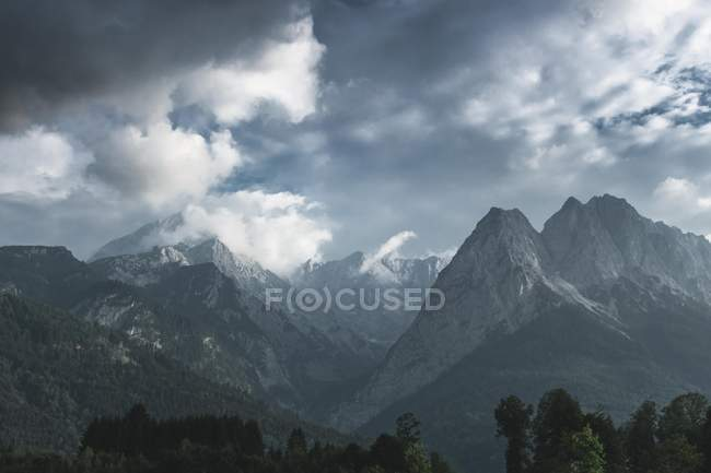 Scenic landscape with beautiful mountains and dark clouds in sky — Photo de stock