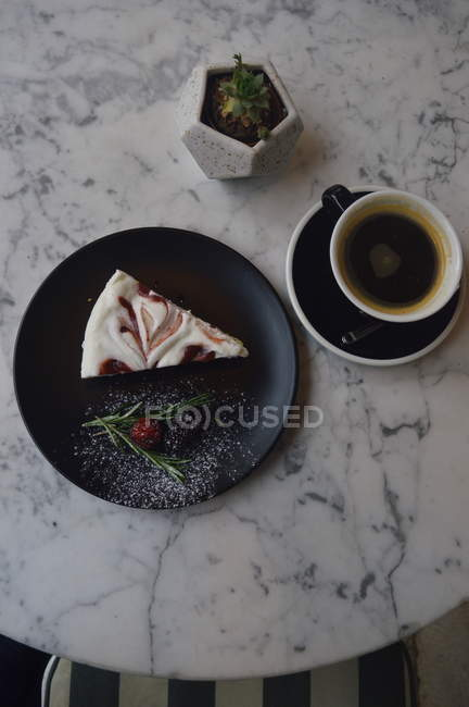 Top view of delicious cake and cup of coffee on white round marble table — Photo de stock