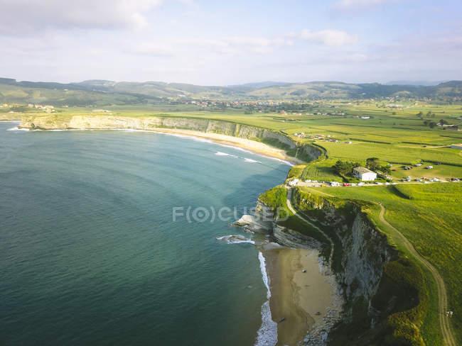 Aerial view of beautiful seashore and grassy cliffs — Fotografia de Stock
