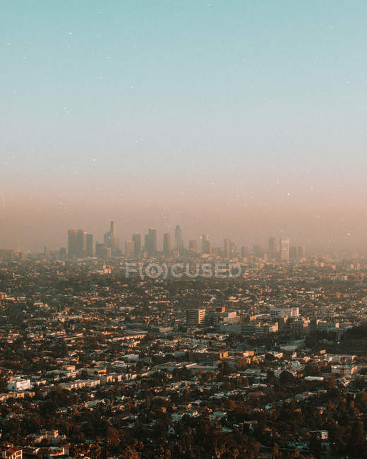 Aerial view of polluted air and urban cityscape in the morning — Stock Photo