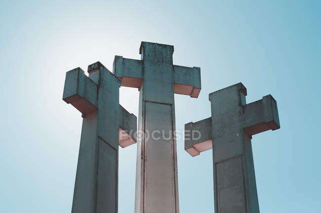 Low angle view of three crosses against clear blue sky — Stock Photo