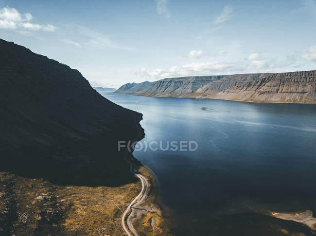 Aerial view of body of water surrounded by land formations — Stock Photo