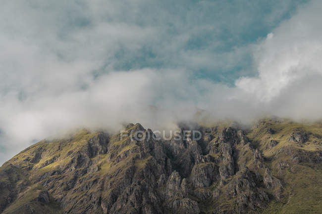 Aerial view of clouds over beautiful rocky mountains — Fotografia de Stock