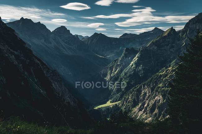 Aerial view of beautiful mountains covered with green vegetation and scenic mountain valley — стокове фото