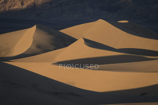 Aerial view of majestic landscape with sand dunes in desert area — Fotografia de Stock