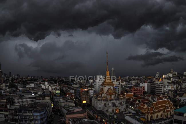 Aerial view of high rustic buildings under dark grey cloudy sky — Stock Photo