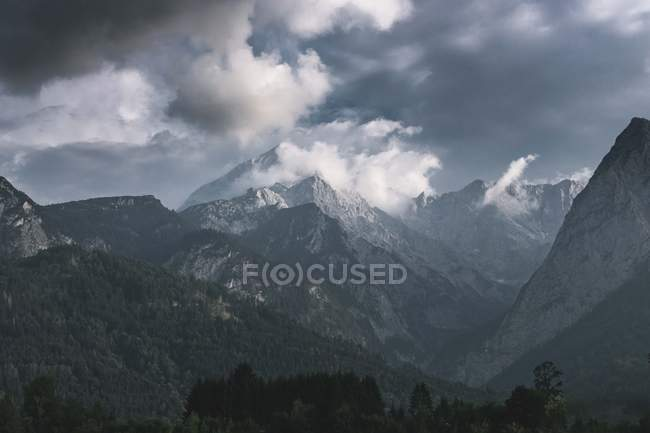 Beautiful landscape with majestic mountains under cloudy sky — Photo de stock
