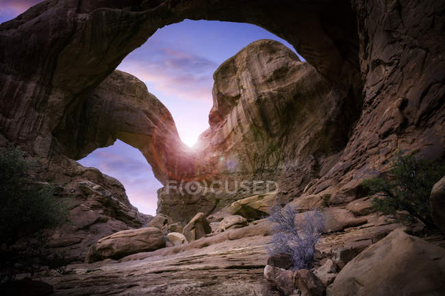 Low angle view of amazing rock formations at sunlight in Arches National Park — Stock Photo
