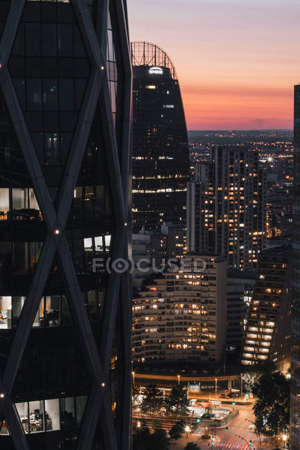 Panoramic photography of urban city with illuminated skyscrapers during nighttime - foto de stock