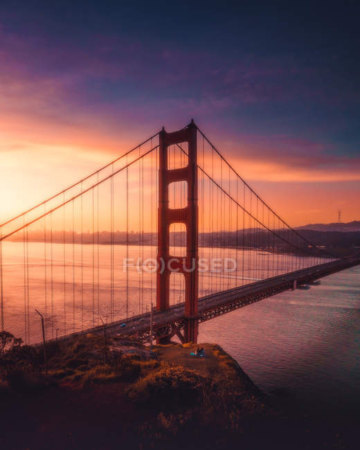 Aerial view of Golden gate bridge near body of water during sunrise — Stock Photo
