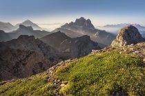 Rays of light behind the Pelmo and the Antelao, as seen from Mount Cernera, DolomitesVeneto, Italy — Stock Photo